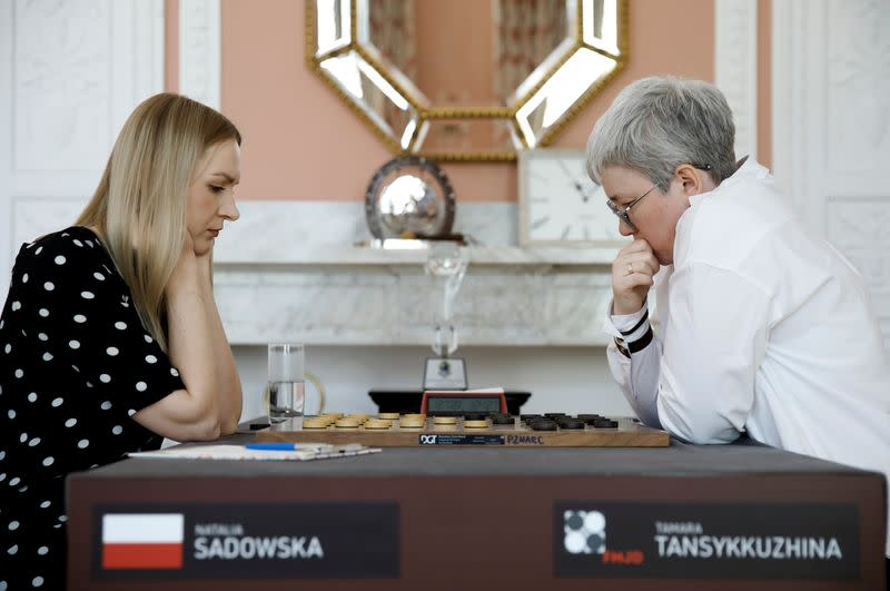 Draught players Polish Natalia Sadowska and Russian Tamara Tansykkuzhina play a game during the Women's World Draughts Championship in Warsaw