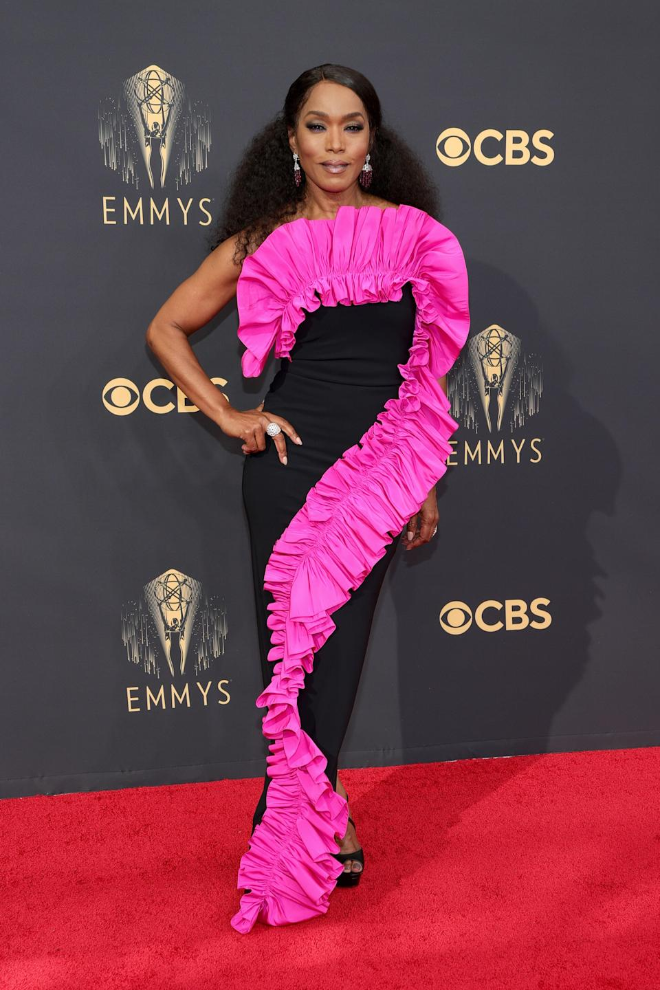 Speaking of icons… Angela Basset opted for this black Greta Constantine dress with a hot pink ruffle detail.