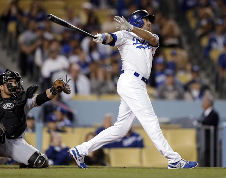 Los Angeles Dodgers' Andre Ethier swings on a solo home run against the Pittsburgh Pirates in the second inning of a baseball game in Los Angeles on Friday, April 5, 2013. (AP Photo/Reed Saxon)