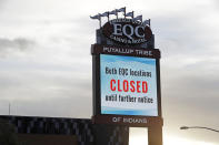In this April 30, 2020 photo, a sign indicates that the new Emerald Queen Casino in Tacoma, Wash., which is owned by the Puyallup Tribe of Indians, is closed. Hundreds of tribal casinos across the country have voluntarily closed because of the coronavirus pandemic, in many cases taking away a tribe's primary source of revenue used to operate tribal government and social programs. (AP Photo/Ted S. Warren)
