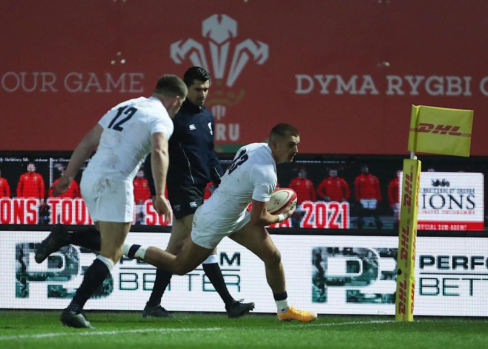 Henry Slade scores England's first try against Wales (AFP via Getty)
