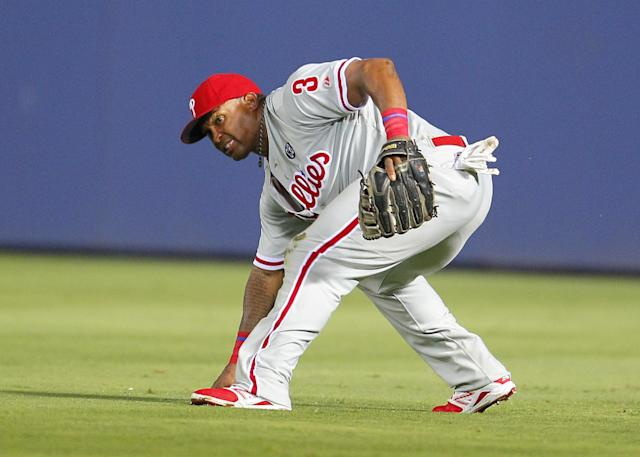 Philadelphia Phillies right fielder Marlon Byrd fields a ball driven to the outfield by Atlanta Braves Andrelton Simmons which advances Chris Johnson to third in the seventh inning of a baseball game Tuesday, June 17, 2014, in Atlanta. (AP Photo/Todd Kirkland)