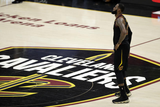 LeBron James confirmed a post-game report that he injured his hand in frustration after Game 1 and played the rest of the Finals with a hand contusion.. (AP Photo/Tony Dejak)