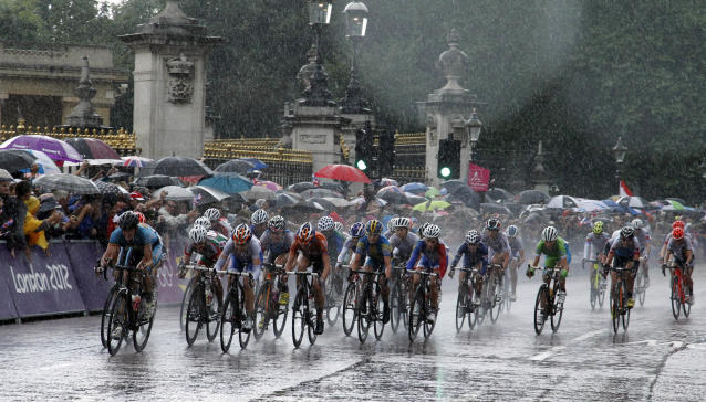 Cyclists pedal under pouring rain during the Women's Road Cycling race at the 2012 Summer Olympics, Sunday, July 29, 2012, in London. (AP Photo/Matt Rourke)