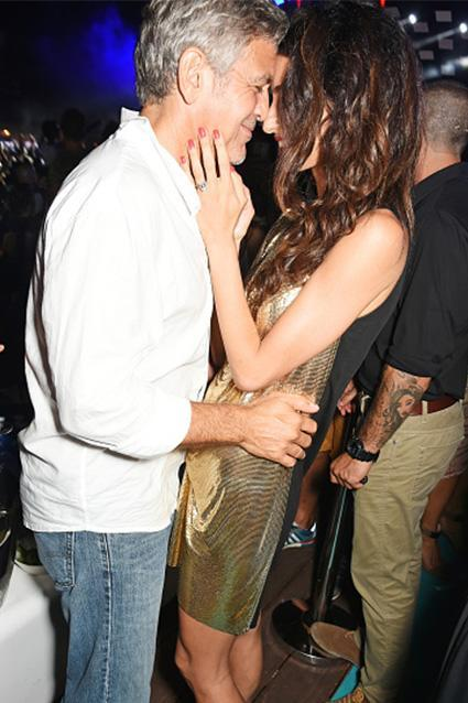 """It's the look of love! George Clooney and his wife Amal showed off their love for one another in the cutest way possible -- by rubbing noses in public during the Spanish launch of George's Casamigos Tequila on Sunday. Getty Images The newlyweds were joined by their pals Cindy Crawford and Rande Gerber. ET can report that the group stayed at George and Amal's estate in Lake Como, Italy, where they hung out for a fun getaway before hopping on a private plane and jetting to Ibiza for Sunday night's launch party. <strong>WATCH: George and Amal Clooney Have the Most Adorable PDA in Italy</strong> The event itself was quite the party, thanks in part to DJ Avicii, and George clearly had a good time. And while Amal blew everyone away with her dazzling, gold fashion, George also shined while meeting his fans. <strong>PHOTO: George Clooney Photobombs Cindy Crawford and Rande Gerber</strong> """"Hola!"""" he adorably said while shaking hands. Meanwhile, Amal was clearly patient as her hubby met with fans. And she was even gracious enough to pose for a photo with George and these lucky fans, who no doubt felt like they were getting the VIP experience. Of course, with Amal by his side, George himself obviously feels pretty lucky. <strong>WATCH: 7 Celebs Who Go Way Too Fair With Their PDA </strong> """"She's an amazing human being,"""" he told ET's Nancy O'Dell in May. """"And she's caring. And she also happens to be one of the smartest people I've ever met. And she's got a great sense of humor."""" He could go on and on! Check out the video below to hear George gush."""