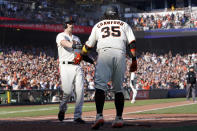 San Francisco Giants' Mike Yastrzemski, left, celebrates with Brandon Crawford after both scored on a two-run triple hit by Steven Duggar during the second inning of a baseball game against the Los Angeles Dodgers in San Francisco, Sunday, Sept. 5, 2021. (AP Photo/Jeff Chiu)