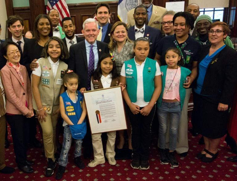 Members of Girl Scout Troop 6000, are honored and recognized for the troop's unique status, as the first troop exclusively for homeless girls