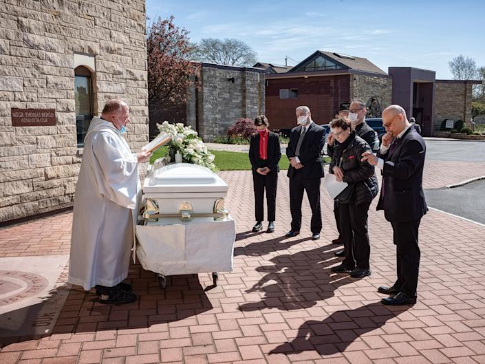 A funeral at St. Raymond New Cemetery in the Bronx, because of the pandemic, only five people are allowed to attend in person on May 5, 2020 in New York City.