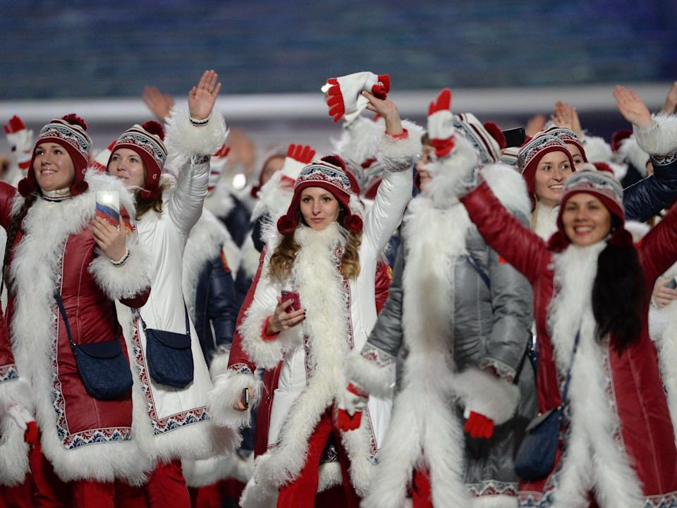 Russia's team at the 2014 Olympics wearing red coats and fur