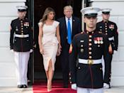 <p>The first lady stepped out to greet the South Korean President in a rose pink peplum dress by Roland Mouret, nude Louboutin pumps, and minimal jewelry.</p>