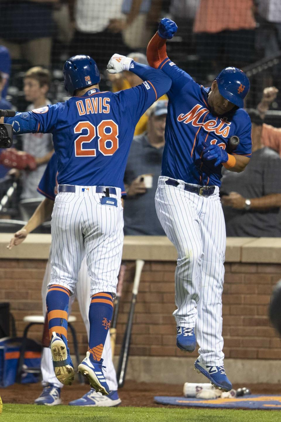 New York Mets' J.D. Davis (28) celebrates with Juan Lagares after hitting a home run in the seventh inning of the second game of a baseball doubleheader against the Miami Marlins, Monday, Aug. 5, 2019, in New York. (AP Photo/Mary Altaffer)