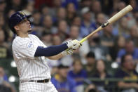 Milwaukee Brewers' Willy Adames watches his two-run home run in the third inning of a baseball game against the New York Mets, Friday, Sept. 24, 2021, in Milwaukee. (AP Photo/Aaron Gash)