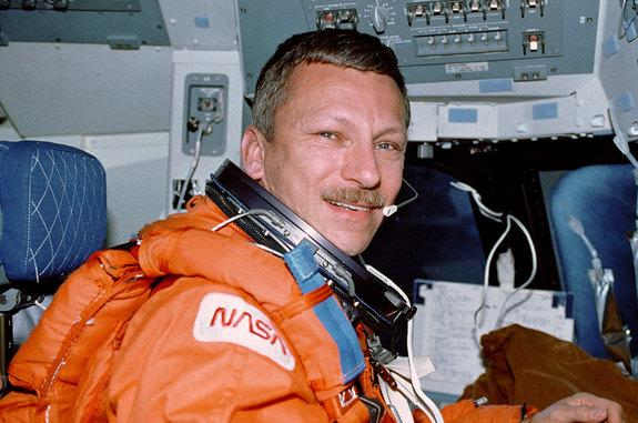 NASA astronaut Steven Nagel is seen in the commander's seat aboard the space shuttle Atlantis during the STS-55 mission in April 1991. Nagel died at age 67 on Aug. 21, 2014.