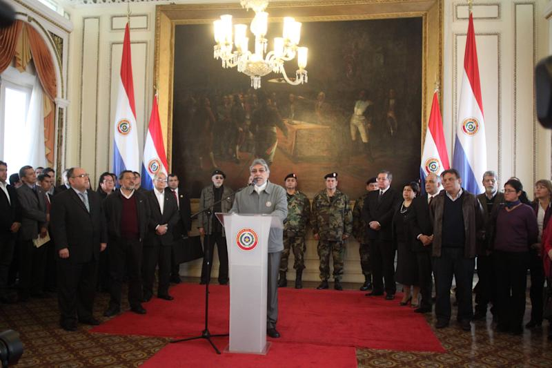Paraguay's President Fernando Lugo gives a news conference in Asuncion, Paraguay, Thursday, June 21, 2012. The lower house of Paraguay's congress has voted to begin impeachment proceedings against Lugo for his role in a violent eviction, after he was heavily criticized over a land eviction last week that killed 17 people in gunbattles between police and landless farmers in a forest reserve. (AP Photo/Cesar Olmedo)