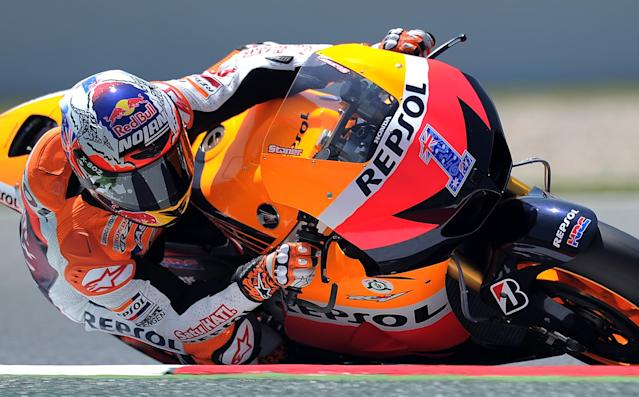 Repsol Honda Team's Australian Casey Stoner takes a curve at the Catalunya racetrack in Montmelo, near Barcelona, on June 1, 2012, during the MotoGP second training session of the Catalunya Moto GP Grand Prix. AFP PHOTO/LLUIS GENELLUIS GENE/AFP/GettyImages