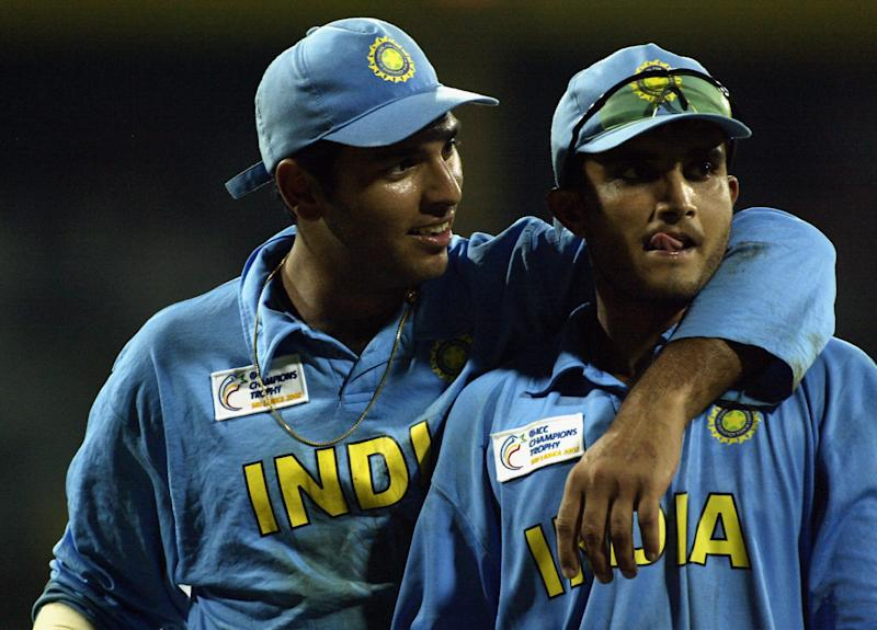 Yuvraj Singh and Sourav Ganguly of India celebrate victory after the ICC Champions Trophy semi-final match between India and South Africa held on September 25, 2002 at the R. Premadasa Stadium, in Colombo, Sri Lanka. (Photo by Clive Mason/Getty Images)