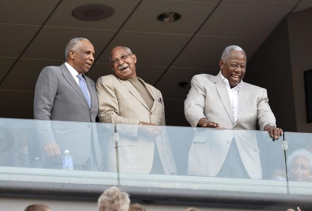 CHICAGO, IL - AUGUST 24: MLB Hall of Famers Frank Robinson (L-R), Billy Williams and Hank Aaron stand as they are acknowledged during the 2013 Civil Rights Game between the Chicago White Sox and the Texas Rangers at U.S. Cellular Field on August 24, 2013 in Chicago, Illinois. (Photo by Brian Kersey/Getty Images)