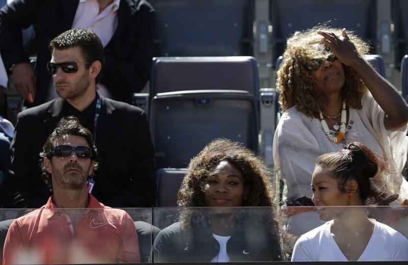 Serena Williams, of the United States, center, coach Patrick Mouratoglou, left, and Oracene Williams, top right, watch the match between Venus Williams and Laura Robson of Britain at the Italian Open tennis tournament in Rome, Monday, May 13, 2013. (AP Photo/Gregorio Borgia)