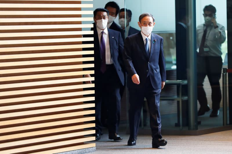 Japan's Chief Cabinet Secretary Yoshihide Suga enters prime minister's official residence in Tokyo