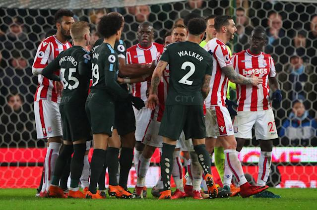 """Soccer Football - Premier League - Stoke City vs Manchester City - bet365 Stadium, Stoke-on-Trent, Britain - March 12, 2018 Players from both sides clash REUTERS/Hannah McKay EDITORIAL USE ONLY. No use with unauthorized audio, video, data, fixture lists, club/league logos or """"live"""" services. Online in-match use limited to 75 images, no video emulation. No use in betting, games or single club/league/player publications. Please contact your account representative for further details."""