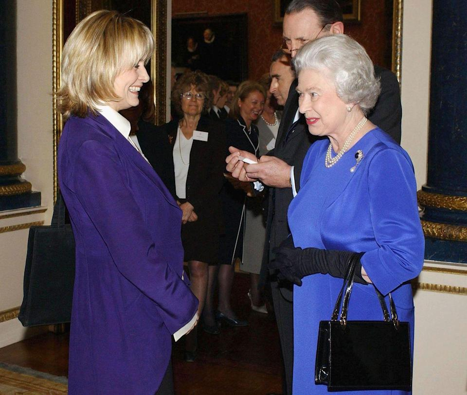 <p>Who wants to bet they're swapping stories of Andy Warhol and Studio 54? Just us? The fashion model paired black pants and a white button-down with a deep purple blazer for the occasion.</p>