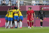 Brazil players celebrate after Marta scoring against China during a women's soccer match at the 2020 Summer Olympics, Wednesday, July 21, 2021, in Rifu, Japan. (AP Photo/Andre Penner)