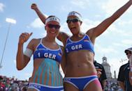 LONDON, ENGLAND - JULY 28: Katrin Holtwick (L) and Ilka Semmler of Germany celebrate their victory in the Women's Beach Volleyball match between Germany and Czech Republic on Day 1 of the London 2012 Olympic Games at Horse Guards Parade on July 28, 2012 in London, England. (Photo by Alexander Hassenstein/Getty Images)