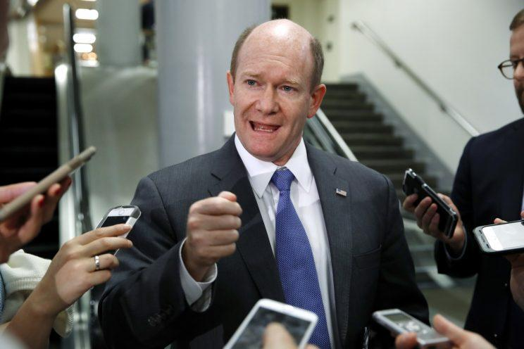 Sen. Chris Coons, D-Del., speaks to reporters at the Capitol in May 2017.