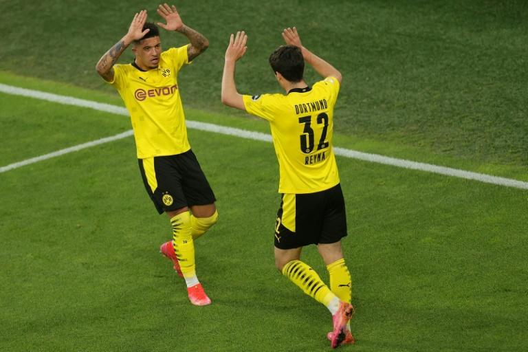US midfielder Giovanni Reyna (R) and Jadon Sancho celebrate Dortmund's German Cup semi-final rout of Kiel