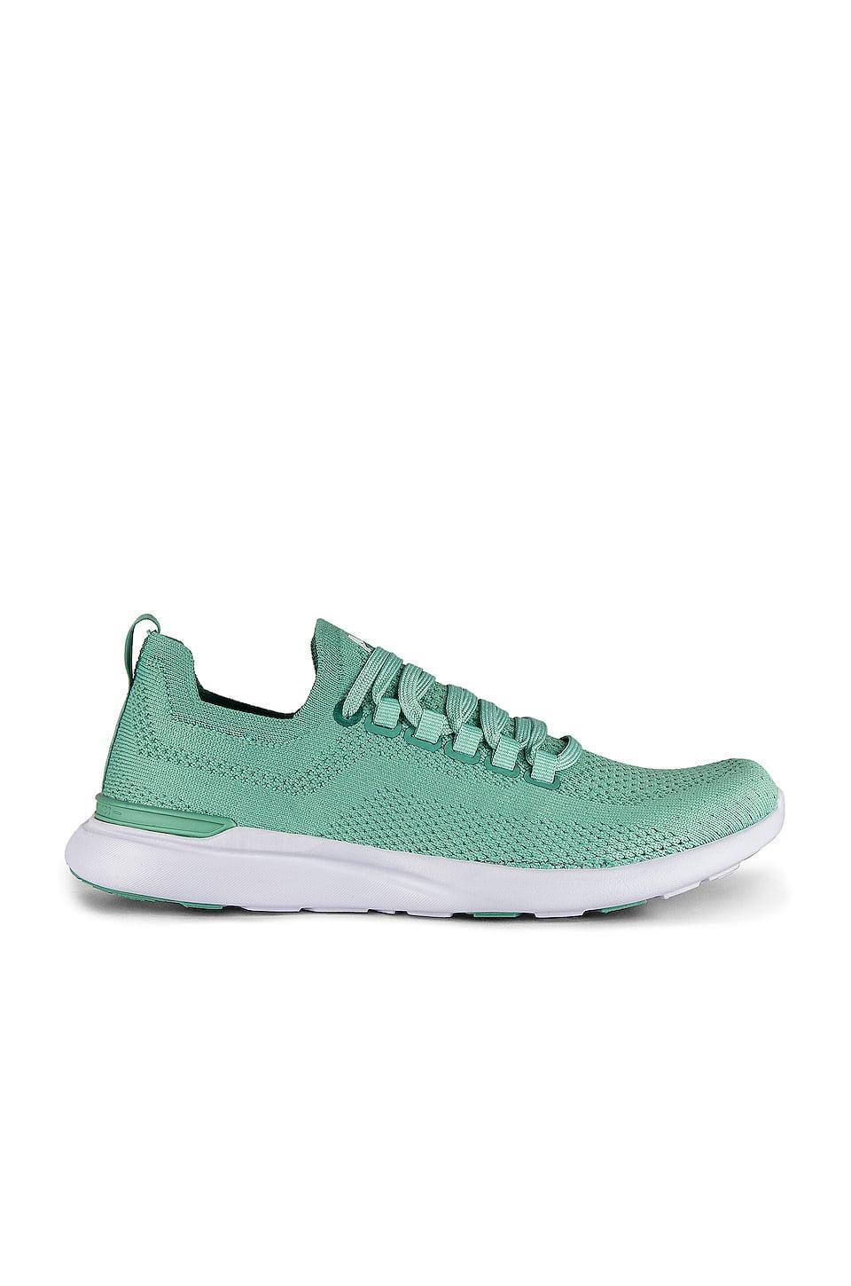"<p>These cute green <a href=""https://www.popsugar.com/buy/APL-Techloom-Breeze-Sneakers-567945?p_name=APL%20Techloom%20Breeze%20Sneakers&retailer=revolve.com&pid=567945&price=200&evar1=fab%3Aus&evar9=47415945&evar98=https%3A%2F%2Fwww.popsugar.com%2Ffashion%2Fphoto-gallery%2F47415945%2Fimage%2F47415953%2FAPL-Techloom-Breeze-Sneakers&list1=shopping%2Cshoes%2Csneakers%2Crevolve&prop13=mobile&pdata=1"" class=""link rapid-noclick-resp"" rel=""nofollow noopener"" target=""_blank"" data-ylk=""slk:APL Techloom Breeze Sneakers"">APL Techloom Breeze Sneakers</a> ($200) were made for working out, but they're also so cute.</p>"