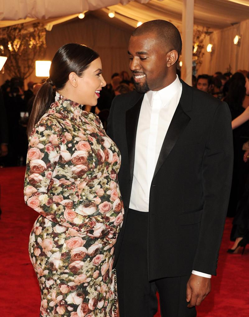 """Kim Kardashian, left, and Kanye West attend The Metropolitan Museum of Art's Costume Institute benefit celebrating """"PUNK: Chaos to Couture"""" on Monday, May 6, 2013, in New York. (Photo by Evan Agostini/Invision/AP)"""