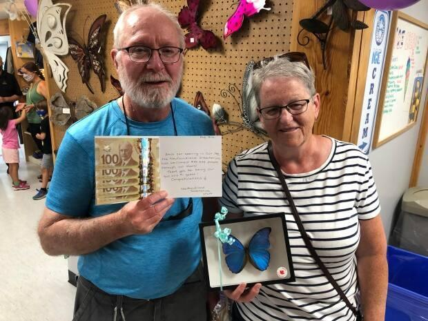 Raymond and Sheila Baker walked into the insectarium on Wednesday afternoon and Raymond won $500 for being the 500,000th customer.  (Colleen Connors/CBC - image credit)