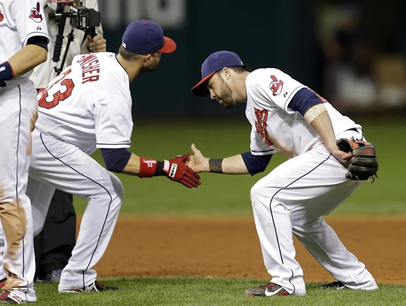 Cleveland Indians' Nick Swisher, left, and Jason Kipnis celebrate after a 4-1 win over the Houston Astros in a baseball game Saturday, Sept. 21, 2013, in Cleveland. (AP Photo/Mark Duncan)