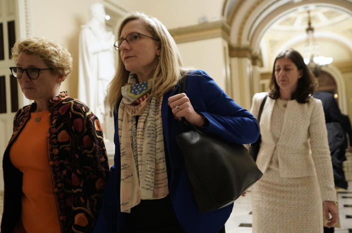 From left, Rep. Chrissy Houlahan D-Pa., Rep Abigail Spanberger D-Va., and Rep Elaine Luria. D-Va., walk at the Capitol in Washington, Wednesday, Dec. 18, 2019, as the House of Representatives debate impeaching President Donald Trump on two charges, abuse of power and obstruction of Congress. (AP Photo/J. Scott Applewhite)