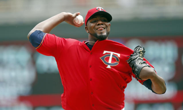 Minnesota Twins pitcher Michael Pineda throws against the Detroit Tigers in the first inning in the first baseball game one of a doubleheader, Saturday, May 11, 2019, in Minneapolis. (AP Photo/Jim Mone)