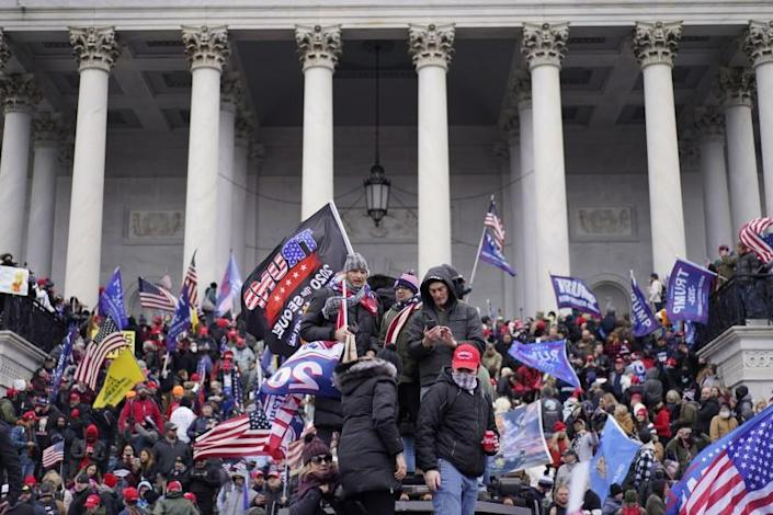 WASHINGTON, DC - JANUARY 06: Protesters gather storm the Capitol and halt a joint session of the 117th Congress on Wednesday, Jan. 6, 2021 in Washington, DC. (Kent Nishimura / Los Angeles Times)