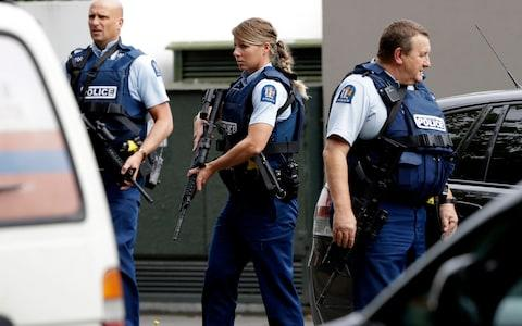 Armed police patrol outside a mosque in central Christchurch - Credit: MARK BAKER/AP