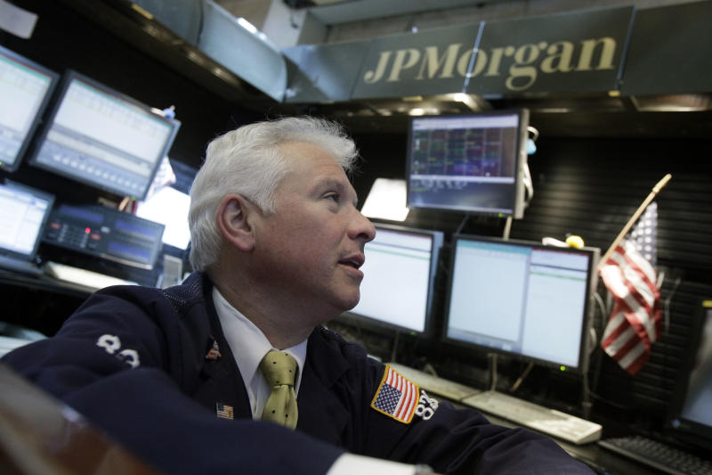Peter Castelli, a vice president with JP Morgan, works in his firm's booth on the floor of the New York Stock Exchange Friday, May 11, 2012. Financial stocks are leading the market lower in early trading after JPMorgan disclosed a huge trading loss.(AP Photo/Richard Drew)