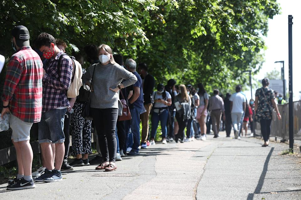 <p>People queuing to go into Belmont Health Centre in Harrow</p> (PA Wire)