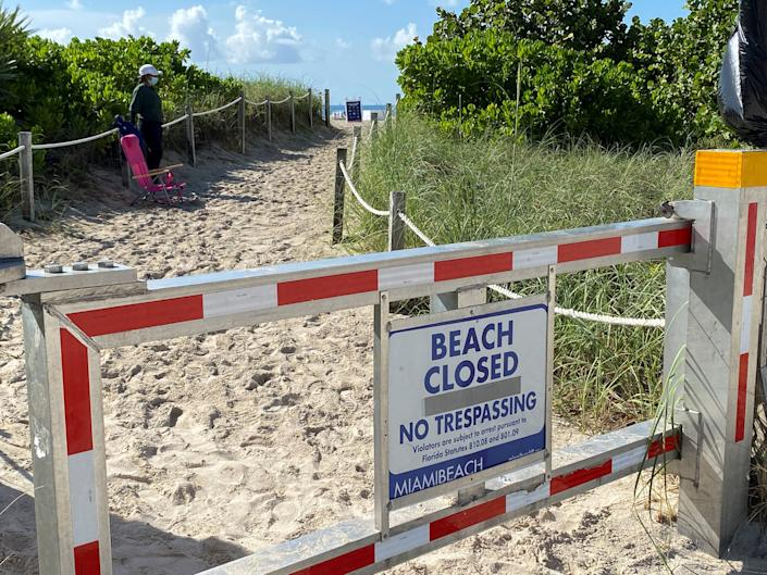 A sign announces beach closure to prevent the spread of the coronavirus ahead of the Fourth of July weekend in Miami Beach, Florida. (Photo: REUTERS/Elizabeth Feria)