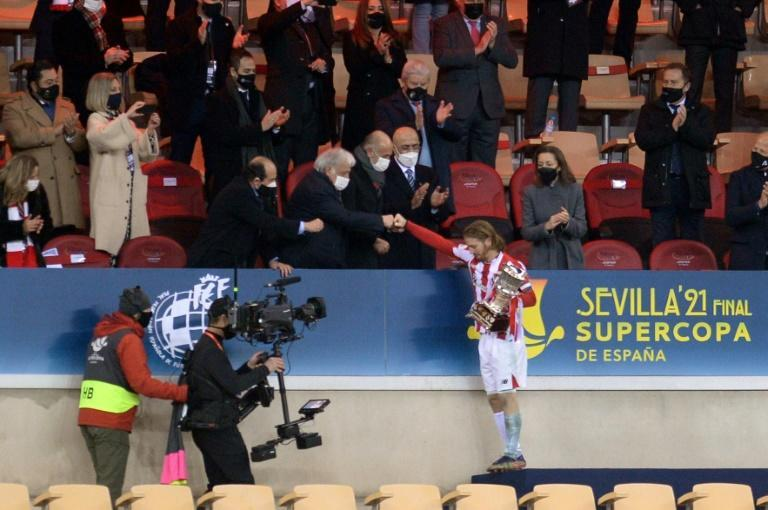 Athletic Bilbao's Iker Muniain receives the winner's trophy at the Spanish Super Cup final