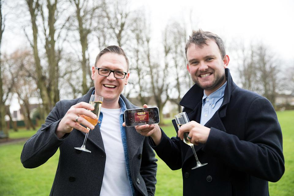 Gareth Bradley (left) won £500,000 on the National Lottery game Mega Cashword, and celebrated with his partner Connor Dennis. (National Lottery/ PA)