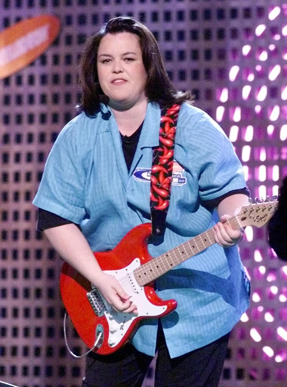 Rosie Odonnel with a guitar