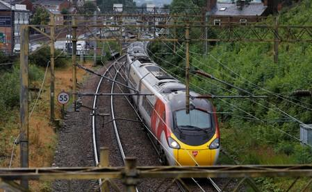 A Virgin Trains West Coast Mainline service from London to Manchester pulls out of the station in Macclesfield