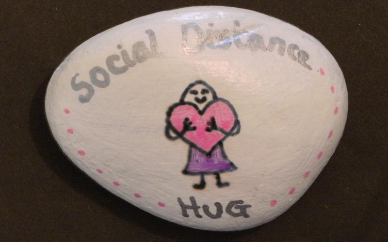 "Stone with ""social distance hug"" written on - PHILIP LLOYD"