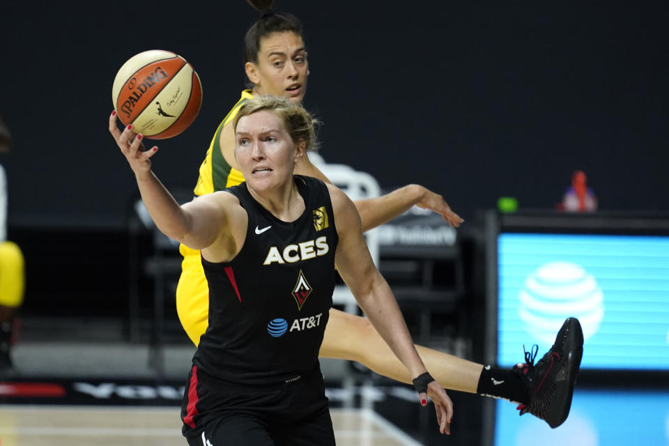 Las Vegas Aces center Carolyn Swords (4) grabs a rebound in front of Seattle Storm forward Breanna Stewart (30) during the first half of Game 1 of basketball's WNBA Finals Friday, Oct. 2, 2020, in Bradenton, Fla. (AP Photo/Chris O'Meara)
