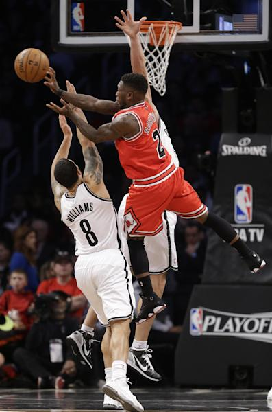 Chicago Bulls guard Nate Robinson (2) passes over the defense of Brooklyn Nets guard Deron Williams (8) in the first half of Game 5 of their first-round NBA basketball playoff series, Monday, April 29, 2013, in New York. (AP Photo/Kathy Willens)