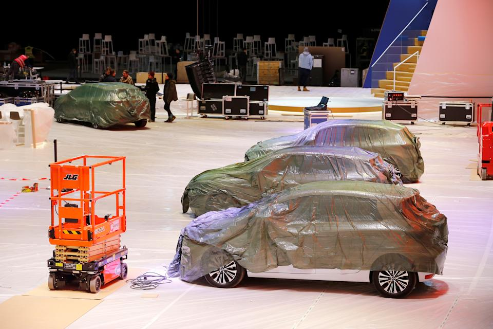 Covered cars are pictured at the Palexpo exhibition centre as the 90th edition of the International Motor Show is cancelled to curb the spread of the coronavirus, in Geneva, Switzerland, February 28, 2020. REUTERS/Pierre Albouy