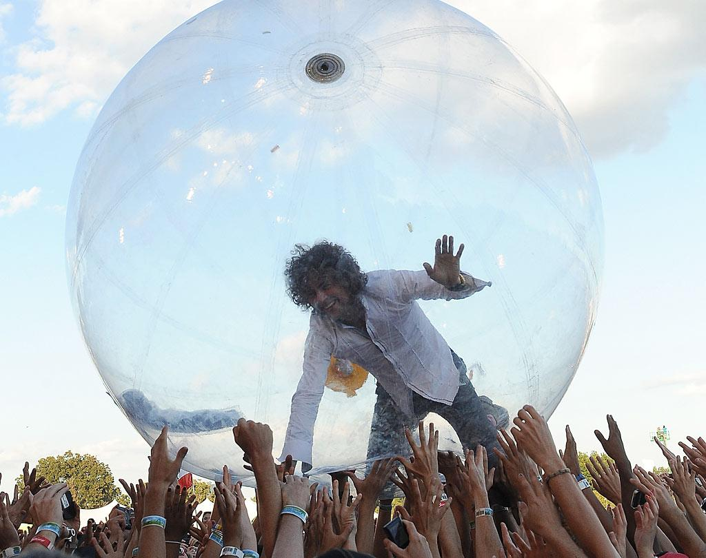"Wayne Coyne of The Flaming Lips put on quite the show during day three of the 2010 Austin City Limits Music Festival in Texas when he crowd surfed in his signature giant bubble! C Flanigan/<a href=""http://www.gettyimages.com/"" target=""new"">GettyImages.com</a> - October 10, 2010"