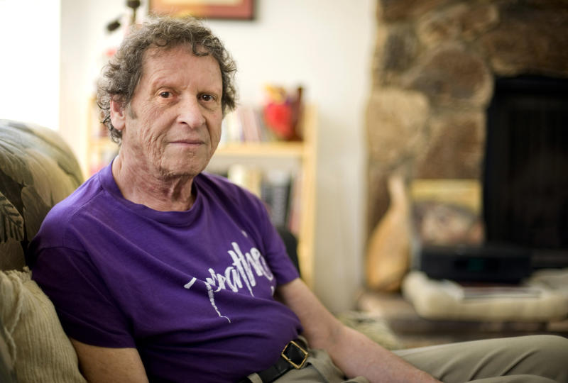 FILE - In this May 7, 2009, file photo, author, comedian and co-founder of the Yippie party as well as stand-up satirist, Paul Krassner, 77, poses for a photo at his home in Desert Hot Springs, Calif. Krassner, the publisher, author and radical political activist on the front lines of 1960s counterculture who helped tie together his loose-knit prankster group by naming them the Yippies, has died. His daughter, Holly Krassner Dawson, says Krassner died Sunday, July 21, 2019, at his home in Desert Hot Springs. He was 87. (AP Photo/Eric Reed, File)